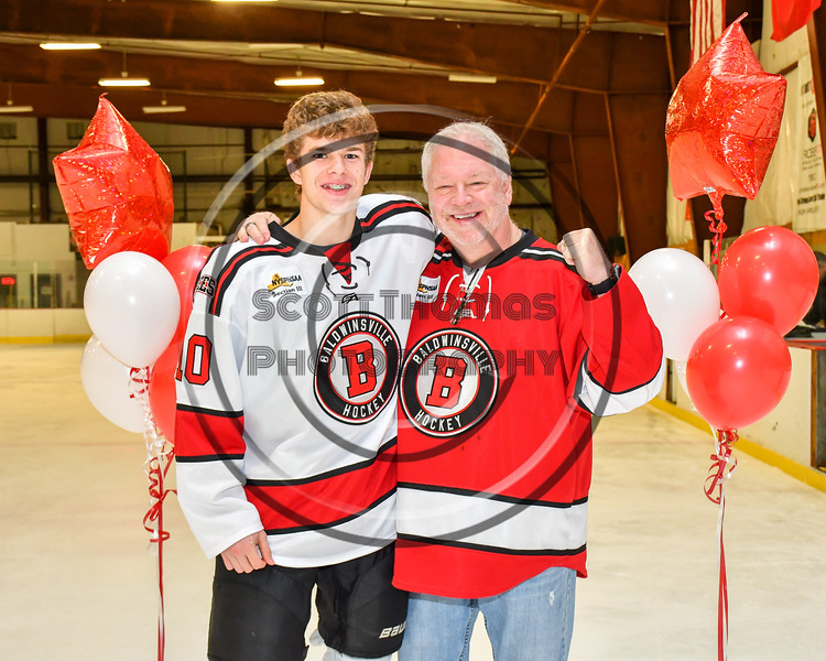 Baldwinsville Bees Cooper Foote (10) honors Mr. Ballard on Teacher Appreciation Night at the Lysander Ice Arena in Baldwinsville, New York on Tuesday, December 18, 2018.