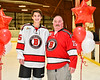 Baldwinsville Bees Zachary Cole (15) honors Mr. Donahue on Teacher Appreciation Night at the Lysander Ice Arena in Baldwinsville, New York on Tuesday, December 18, 2018.