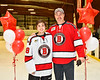 Baldwinsville Bees Matt Speelman (18) honors Mr. Sweeney on Teacher Appreciation Night at the Lysander Ice Arena in Baldwinsville, New York on Tuesday, December 18, 2018.