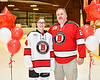 Baldwinsville Bees Team Manager Jace Ordway honors Mr. Young on Teacher Appreciation Night at the Lysander Ice Arena in Baldwinsville, New York on Tuesday, December 18, 2018.
