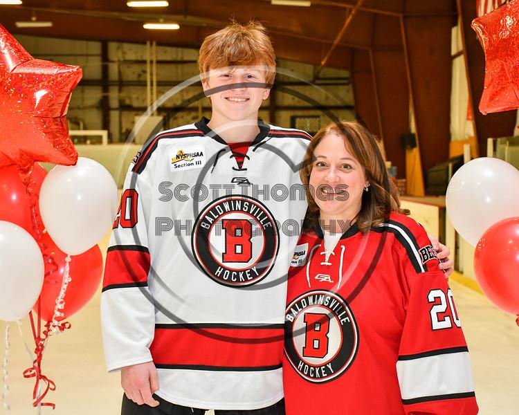Baldwinsville Bees Casey Scott (20) honors Mrs. Ramin on Teacher Appreciation Night at the Lysander Ice Arena in Baldwinsville, New York on Tuesday, December 18, 2018.