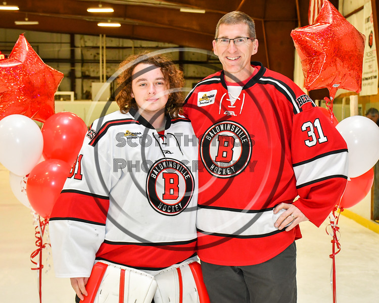 Baldwinsville Bees goalie Tommy Blais (31) honors Mr. Ludden on Teacher Appreciation Night at the Lysander Ice Arena in Baldwinsville, New York on Tuesday, December 18, 2018.