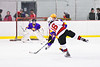 Baldwinsville Bees Luke Hoskin (16) fires the puck at the CBA/JD Brothers net in NYSPHSAA Section III Boys Ice Hockey action at the Lysander Ice Arena in Baldwinsville, New York on Tuesday, December 18, 2018. Baldwinsville won 3-1.