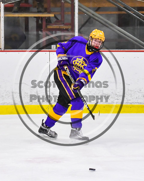 CBA/JD Brothers Turner Pomeroy (2) passes the puck against the Baldwinsville Bees in NYSPHSAA Section III Boys Ice Hockey action at the Lysander Ice Arena in Baldwinsville, New York on Tuesday, December 18, 2018. Baldwinsville won 3-1.