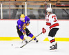CBA/JD Brothers Simon Lessor (3) with the puck against Baldwinsville Bees Christian Treichler (33) in NYSPHSAA Section III Boys Ice Hockey action at the Lysander Ice Arena in Baldwinsville, New York on Tuesday, December 18, 2018. Baldwinsville won 3-1.
