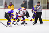 Baldwinsville Bees Nick Glamos (14) facing off against the CBA/JD Brothers in NYSPHSAA Section III Boys Ice Hockey action at the Lysander Ice Arena in Baldwinsville, New York on Tuesday, December 18, 2018. Baldwinsville won 3-1.