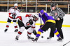 Baldwinsville Bees Mark Monaco (22) and CBA/JD Brothers Adam Louise (16) face-off to start a NYSPHSAA Section III Boys Ice Hockey game at the Lysander Ice Arena in Baldwinsville, New York on Tuesday, December 18, 2018. Baldwinsville won 3-1.