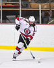 Baldwinsville Bees Alexander Pompo (5) with the puck against the CBA/JD Brothers in NYSPHSAA Section III Boys Ice Hockey action at the Lysander Ice Arena in Baldwinsville, New York on Tuesday, December 18, 2018. Baldwinsville won 3-1.