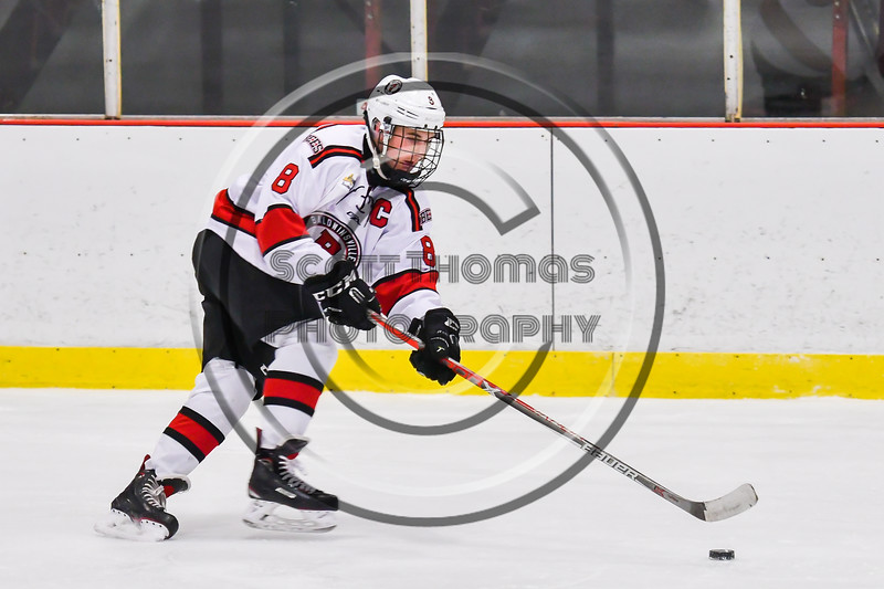 Baldwinsville Bees Parker Schroeder (8) skating with the puck against the CBA/JD Brothers in NYSPHSAA Section III Boys Ice Hockey action at the Lysander Ice Arena in Baldwinsville, New York on Tuesday, December 18, 2018. Baldwinsville won 3-1.