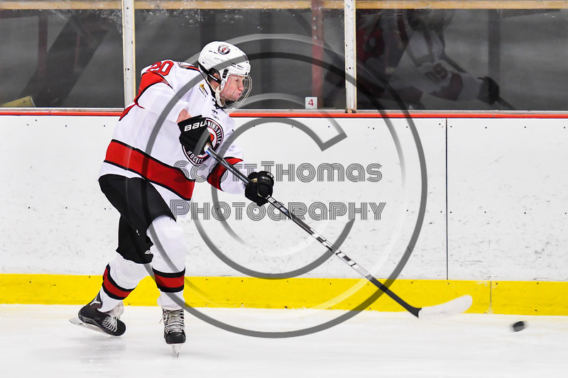 Baldwinsville Bees Casey Scott (20) fires the puck at the CBA/JD Brothers net in NYSPHSAA Section III Boys Ice Hockey action at the Lysander Ice Arena in Baldwinsville, New York on Tuesday, December 18, 2018. Baldwinsville won 3-1.