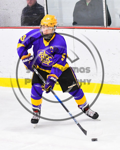 CBA/JD Brothers Kodi Dotterer (9) looking to make a play against the Baldwinsville Bees in NYSPHSAA Section III Boys Ice Hockey action at the Lysander Ice Arena in Baldwinsville, New York on Tuesday, December 18, 2018. Baldwinsville won 3-1.