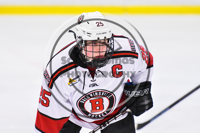 Baldwinsville Bees Jamey Natoli (25) before a face-off against the CBA/JD Brothers in NYSPHSAA Section III Boys Ice Hockey action at the Lysander Ice Arena in Baldwinsville, New York on Tuesday, December 18, 2018. Baldwinsville won 3-1.