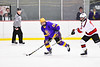 Baldwinsville Bees Alexander Pompo (5) checking CBA/JD Brothers Bailey Doust (28) in NYSPHSAA Section III Boys Ice Hockey action at the Lysander Ice Arena in Baldwinsville, New York on Tuesday, December 18, 2018. Baldwinsville won 3-1.
