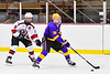 CBA/JD Brothers Adam Lousie (16) with the puck against Baldwinsville Bees Parker Schroeder (8) in NYSPHSAA Section III Boys Ice Hockey action at the Lysander Ice Arena in Baldwinsville, New York on Tuesday, December 18, 2018. Baldwinsville won 3-1.