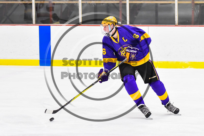 CBA/JD Brothers Cole Mathews (6) with the puck against the Baldwinsville Bees in NYSPHSAA Section III Boys Ice Hockey action at the Lysander Ice Arena in Baldwinsville, New York on Tuesday, December 18, 2018. Baldwinsville won 3-1.