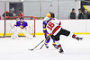Baldwinsville Bees Luke Hoskin (16) leans into a shot against the CBA/JD Brothers in NYSPHSAA Section III Boys Ice Hockey action at the Lysander Ice Arena in Baldwinsville, New York on Tuesday, December 18, 2018. Baldwinsville won 3-1.