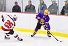 CBA/JD Brothers Koki Dotterer (9) with the puck against Baldwinsville Bees Jamey Natoli (25) in NYSPHSAA Section III Boys Ice Hockey action at the Lysander Ice Arena in Baldwinsville, New York on Tuesday, December 18, 2018. Baldwinsville won 3-1.