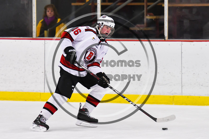 Baldwinsville Bees Luke Hoskin (16) with the puck against the CBA/JD Brothers in NYSPHSAA Section III Boys Ice Hockey action at the Lysander Ice Arena in Baldwinsville, New York on Tuesday, December 18, 2018. Baldwinsville won 3-1.
