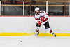 Baldwinsville Bees Christian Treichler (33) passes the puck against the CBA/JD Brothers in NYSPHSAA Section III Boys Ice Hockey action at the Lysander Ice Arena in Baldwinsville, New York on Tuesday, December 18, 2018. Baldwinsville won 3-1.