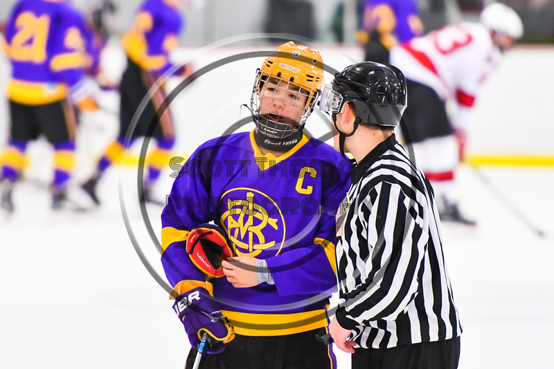 CBA/JD Brothers Kodi Dotterer (9) discusses his penalty call with the referee in NYSPHSAA Section III Boys Ice Hockey action at the Lysander Ice Arena in Baldwinsville, New York on Tuesday, December 18, 2018. Baldwinsville won 3-1.