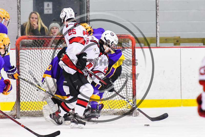 Baldwinsville Bees Mark Monaco (22) with the puck against the CBA/JD Brothers in NYSPHSAA Section III Boys Ice Hockey action at the Lysander Ice Arena in Baldwinsville, New York on Tuesday, December 18, 2018. Baldwinsville won 3-1.