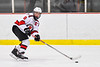 Baldwinsville Bees Parker Schroeder (8) looking to make a play against the CBA/JD Brothers in NYSPHSAA Section III Boys Ice Hockey action at the Lysander Ice Arena in Baldwinsville, New York on Tuesday, December 18, 2018. Baldwinsville won 3-1.