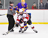 Baldwinsville Bees Nick Glamos (14) comes away with the puck against the CBA/JD Brothers in NYSPHSAA Section III Boys Ice Hockey action at the Lysander Ice Arena in Baldwinsville, New York on Tuesday, December 18, 2018. Baldwinsville won 3-1.