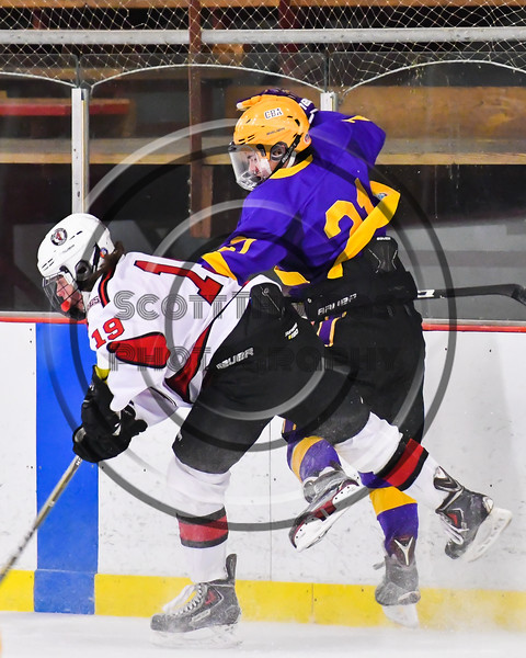 Baldwinsville Bees Michael Marsallo (19) checks CBA/JD Brothers Ian Henderson (21) in NYSPHSAA Section III Boys Ice Hockey action at the Lysander Ice Arena in Baldwinsville, New York on Tuesday, December 18, 2018. Baldwinsville won 3-1.