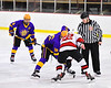 Baldwinsville Bees Mark Monaco (22) facing off against CBA/JD Brothers Adam Louise (16) in NYSPHSAA Section III Boys Ice Hockey action at the Lysander Ice Arena in Baldwinsville, New York on Tuesday, December 18, 2018. Baldwinsville won 3-1.