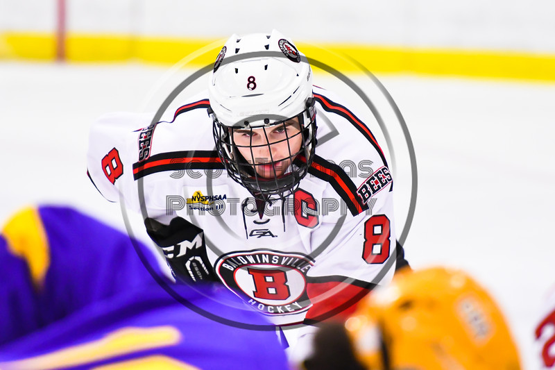 Baldwinsville Bees Parker Schroeder (8) before a face-off against the CBA/JD Brothers in NYSPHSAA Section III Boys Ice Hockey action at the Lysander Ice Arena in Baldwinsville, New York on Tuesday, December 18, 2018. Baldwinsville won 3-1.