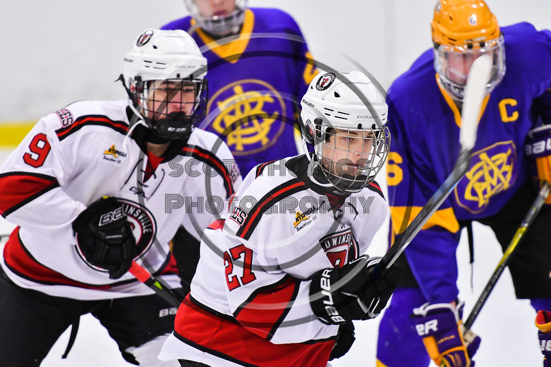 Baldwinsville Bees Tyler DeRito (27) playing against the CBA/JD Brothers in NYSPHSAA Section III Boys Ice Hockey action at the Lysander Ice Arena in Baldwinsville, New York on Tuesday, December 18, 2018. Baldwinsville won 3-1.