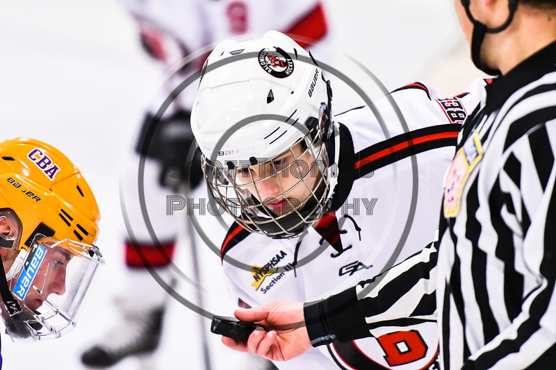 Baldwinsville Bees Tyler DeRito (27) before a face-off against the CBA/JD Brothers in NYSPHSAA Section III Boys Ice Hockey action at the Lysander Ice Arena in Baldwinsville, New York on Tuesday, December 18, 2018. Baldwinsville won 3-1.