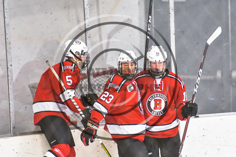 Baldwinsville Bees Alexander Pompo (5) and Luke Hoskin (16) congratulated Braden Lynch (23) on his goal against the Ontario Storm in NYSPHSAA Section III Boys Ice hockey action at Haldane Memorial Arena in Pulaski, New York on Thursday, December 20, 2018. Baldwinsville won 12-0.