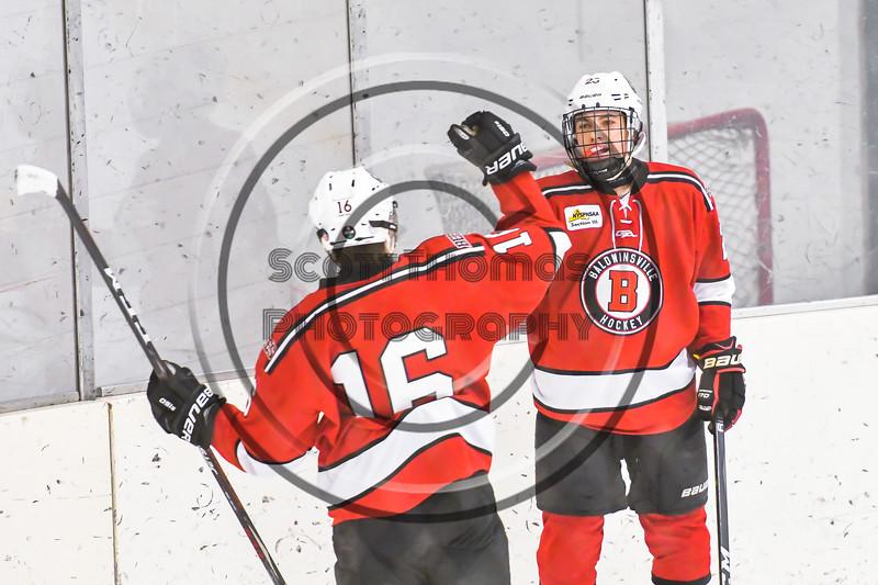 Baldwinsville Bees Luke Hoskin (16) congratulates Braden Lynch (23) on his goal against the Ontario Storm in NYSPHSAA Section III Boys Ice hockey action at Haldane Memorial Arena in Pulaski, New York on Thursday, December 20, 2018. Baldwinsville won 12-0.