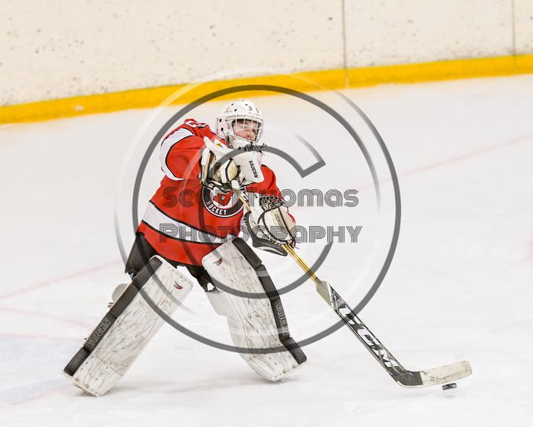 Baldwinsville Bees goalie Bradley O'Neill (30) passes the puck against the Ontario Storm in NYSPHSAA Section III Boys Ice hockey action at Haldane Memorial Arena in Pulaski, New York on Thursday, December 20, 2018. Baldwinsville won 12-0.