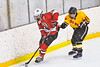 Baldwinsville Bees Cameron Sweeney (21) with the puck against Ontario Storm Jarred Willis (15) in NYSPHSAA Section III Boys Ice hockey action at Haldane Memorial Arena in Pulaski, New York on Thursday, December 20, 2018. Baldwinsville won 12-0.