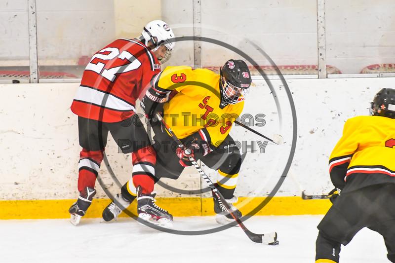 Baldwinsville Bees Tyler DeRito (27) battles for the puck with Ontario Storm Casey Wilson (3) in NYSPHSAA Section III Boys Ice hockey action at Haldane Memorial Arena in Pulaski, New York on Thursday, December 20, 2018. Baldwinsville won 12-0.