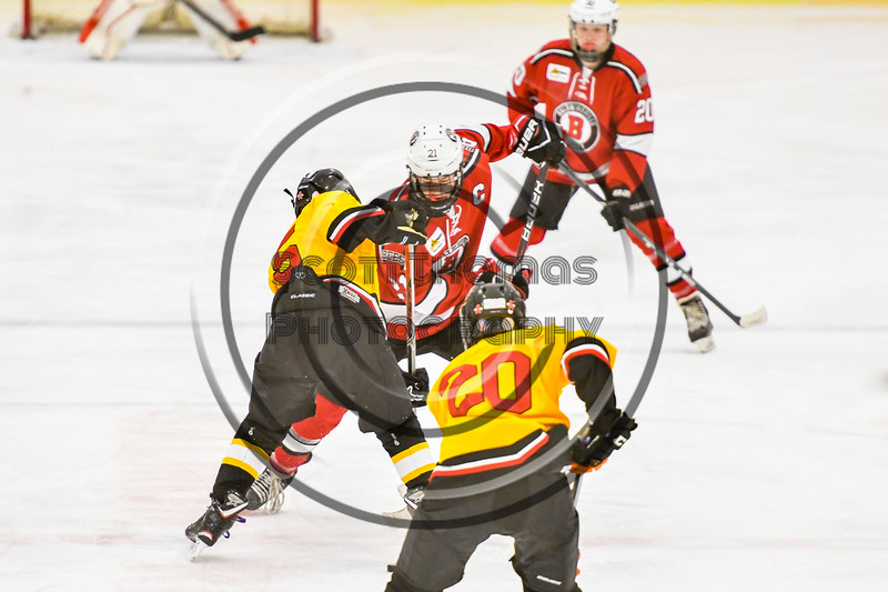 Baldwinsville Bees Cameron Sweeney (21) facing off against an Ontario Storm player in NYSPHSAA Section III Boys Ice hockey action at Haldane Memorial Arena in Pulaski, New York on Thursday, December 20, 2018. Baldwinsville won 12-0.