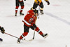 Baldwinsville Bees Alexander Pompo (5) goes between the lets to pass the puck against the Ontario Storm in NYSPHSAA Section III Boys Ice hockey action at Haldane Memorial Arena in Pulaski, New York on Thursday, December 20, 2018. Baldwinsville won 12-0.