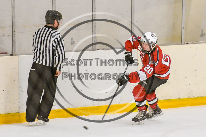 Baldwinsville Bees Casey Scott (20) passes the puck against the Ontario Storm in NYSPHSAA Section III Boys Ice hockey action at Haldane Memorial Arena in Pulaski, New York on Thursday, December 20, 2018. Baldwinsville won 12-0.