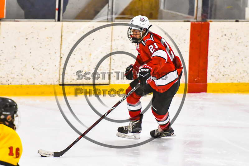 Baldwinsville Bees Cameron Sweeney (21) carrying the puck against the Ontario Storm in NYSPHSAA Section III Boys Ice hockey action at Haldane Memorial Arena in Pulaski, New York on Thursday, December 20, 2018. Baldwinsville won 12-0.