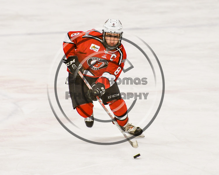 Baldwinsville Bees Parker Schroeder (8) skating with the puck against the Ontario Storm in NYSPHSAA Section III Boys Ice hockey action at Haldane Memorial Arena in Pulaski, New York on Thursday, December 20, 2018. Baldwinsville won 12-0.