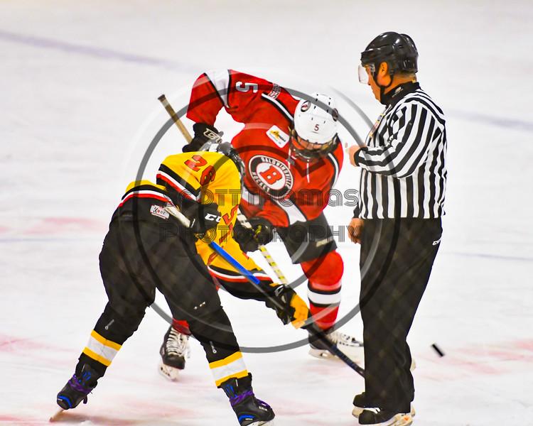 Baldwinsville Bees Alexander Pompo (5) facing off against Ontario Storm Ryan Blevins (26) in NYSPHSAA Section III Boys Ice hockey action at Haldane Memorial Arena in Pulaski, New York on Thursday, December 20, 2018. Baldwinsville won 12-0.