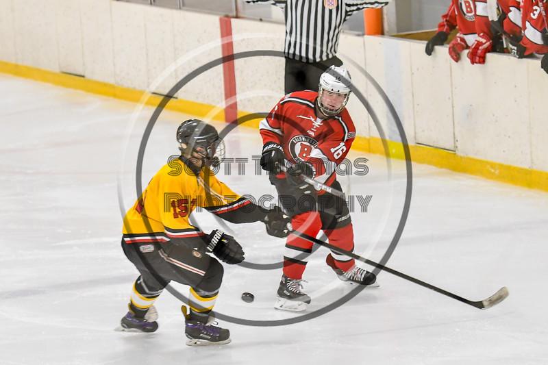 Baldwinsville Bees Luke Hoskin (16) passes the puck against Ontario Storm Jarred Willis (15) in NYSPHSAA Section III Boys Ice hockey action at Haldane Memorial Arena in Pulaski, New York on Thursday, December 20, 2018. Baldwinsville won 12-0.