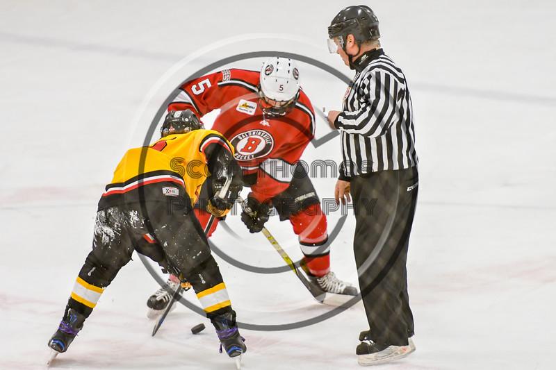 Baldwinsville Bees Alexander Pompo (5) facing off against an Ontario Storm player in NYSPHSAA Section III Boys Ice hockey action at Haldane Memorial Arena in Pulaski, New York on Thursday, December 20, 2018. Baldwinsville won 12-0.