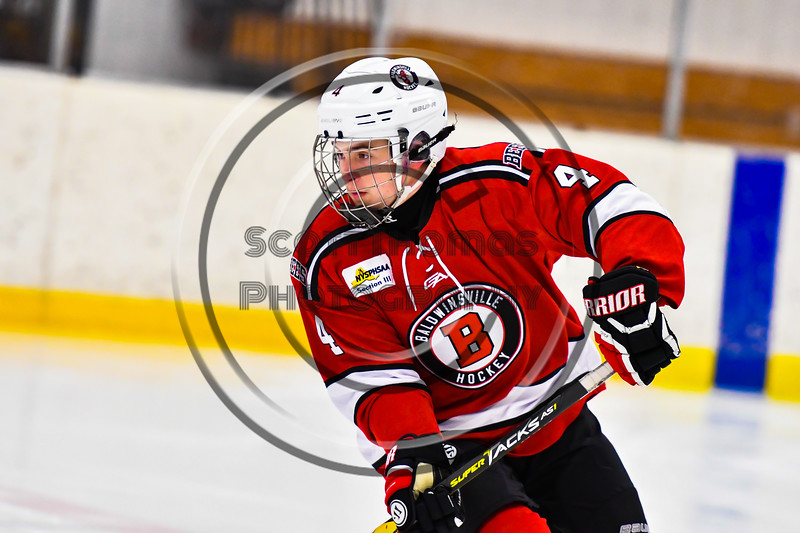 Baldwinsville Bees Quinn Sweeney (4) warming up before playing the Ontario Storm in a NYSPHSAA Section III Boys Ice hockey game at Haldane Memorial Arena in Pulaski, New York on Thursday, December 20, 2018.