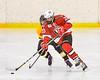 Baldwinsville Bees Christian Treichler (33) stakes past an  Ontario Storm defender in NYSPHSAA Section III Boys Ice hockey action at Haldane Memorial Arena in Pulaski, New York on Thursday, December 20, 2018. Baldwinsville won 12-0.