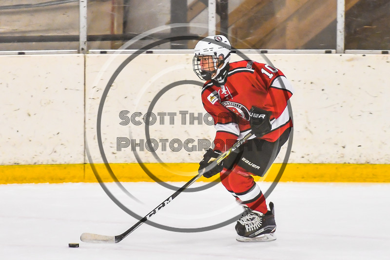 Baldwinsville Bees Cooper Foote (10) with the puck against the Ontario Storm in NYSPHSAA Section III Boys Ice hockey action at Haldane Memorial Arena in Pulaski, New York on Thursday, December 20, 2018. Baldwinsville won 12-0.