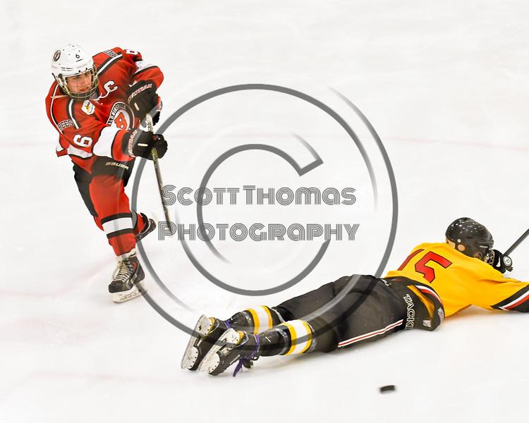 Baldwinsville Bees Michael Carni (6) shoots and scores over Ontario Storm Jarred Willis (15) in NYSPHSAA Section III Boys Ice hockey action at Haldane Memorial Arena in Pulaski, New York on Thursday, December 20, 2018. Baldwinsville won 12-0.