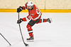 Baldwinsville Bees Mark Monaco (22) leans into a shot at the Ontario Storm net in NYSPHSAA Section III Boys Ice hockey action at Haldane Memorial Arena in Pulaski, New York on Thursday, December 20, 2018. Baldwinsville won 12-0.
